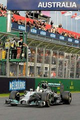 Mercedes driver Nico Rosberg of Germany crosses the finish line to win the 2014 formula one Australian Grand Prix in Melbourne.