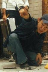 James Wan on the set of <i>Saw</i>.