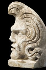The ancient Roman carving with a striking resemblance to Elvis Presley  is to be auctioned in London in October.