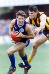 Former AFL player Doug Hawkins during his playing days.