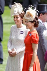 Kate opted for a white lace Dolce & Gabbana dress, while Mary wore an orange Marc Jacobs number.