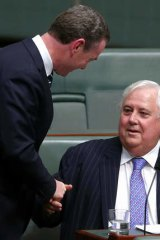 Palmer United Party leader Clive Palmer shakes hands with leader of the house Christopher Pyne after speaking on the carbon tax in the House of Representatives on Monday.