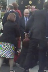 Pressure... Julia Gillard collapses at the service.