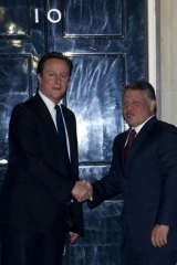 British Prime Minister David Cameron (L) with Jordan's King Abdullah outside 10 Downing Street.