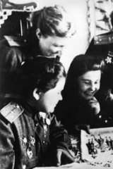 Volunteer bombers: Squadron commander Nadezhda Popova, second from right, with fellow Soviet pilots in 1945.