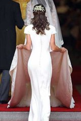 Beholder of that ass: Pippa Middleton's rear has not gone unnoticed by Karl Lagerfeld, even if he did disapprove of her face.