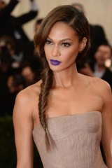 Purple reigns: model Joan Smalls attends a function at New York's Metropolitan Museum of Art in May.