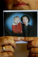 Stunned by the truth … intercountry adoptee Kim Myung-Soo as a baby with her older sister in Korea.