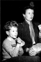 Kim Carpenter as a young boy, watching the opera <i>Tosca</i> with his mother in 1955.