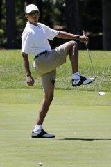 Barack Obama during a round of golf at the Farm Neck Golf Club, Martha's Vineyard, in 2013.