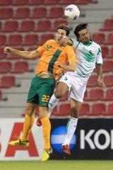 Matthew Spiranovic of Australia competes with Nashat Akram of Iraq in Doha last year.