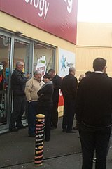 Tech rage ... Early bird customers queue outside a Noel Leeming electronics store in Wellington, New Zealand.