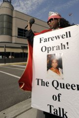 An Oprah fan stands outside Harpo Studios.