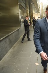 Former Carlton footballer Nick Stevens leaving court after pleading guilty to assaulting his former partner.