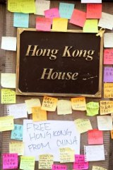 Colorful post-it notes are stuck on the outside of Hong Kong House in Sydney.