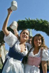 "Two women wearing ""dirndls"" the Bavarian traditional clothes, during the opening parade of Munich's famed Oktoberfest beer party."