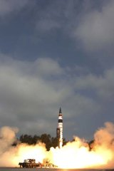 Take off ... India's Agni-V missile launch yesterday.