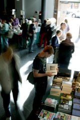 A writers' festival crowd surveys the offerings.