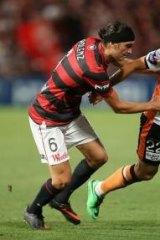 Big task .. Jerome Polenz challenges Brisbane's Thomas Broich.