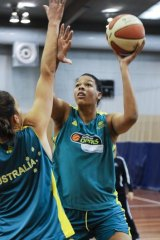 2nd May 2012, Canberra Times poto by Rohan Thomson, Opals training  Liz Cambageshoots over Mariana Tolo