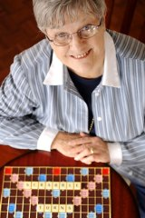 Victorian Scrabble Association president Marj Miller helps celebrate 60 years of the game.