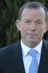 Opposition Leader Tony Abbott addresses media questions about his time in university politics after visiting the Ainslie shopping centre in Canberra on Friday, 14 September.