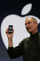 Steve Jobs holds up the first iPhone during his keynote address at MacWorld Conference & Expo in San Francisco in 2007.