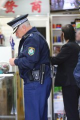 Police inspect tobacconists in Sydney's south-west