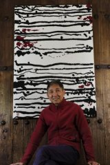 Hou Leong with his work <i>24 Black Horizontal Lines on White</i> at The Silk Road Gallery.