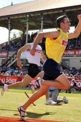 Too quick . . . Tom Burbidge claims the Stawell Gift yesterday.