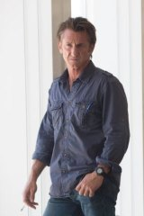 Sean Penn produced, co-wrote and stars in <i>The Gunman</i>.
