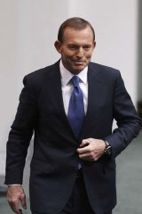 Satisfied: Opposition leader Tony Abbott after delivering his budget response.