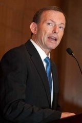 Attempting to ease internal divisions over foreign investment policy ... Opposition Leader Tony Abbott.
