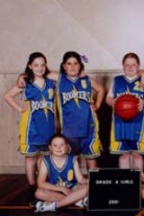 Head and shoulders above her childhood teammates.