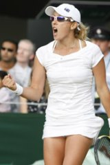 Anastasia Rodionova of Australia reacts as she defeats Svetlana Kuznetsova of Russia.
