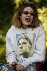 A Nirvana fan wears a hoodie with an image of Kurt Cobain.