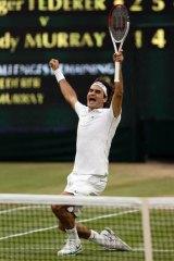 Roger Federer celebrates his seventh Wimbledon men's singles title.