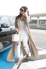 Proportions matter ... Kim Kardashian shows how petite women can rock a duster.