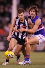 Caught: Ryan Griffen tackles Jamie Elliott.