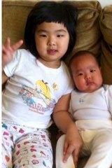 Parent's love: Ms Gu's two children.