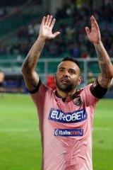 Victory-bound: Fabrizio Miccoli salutes Palermo fans.