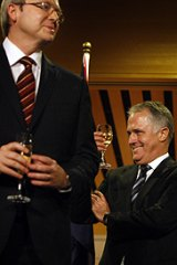 Warring wizards ... Kevin Rudd and Malcolm Turnbull toast the visiting King of Spain, Juan Carlos, at Parliament House yesterday.