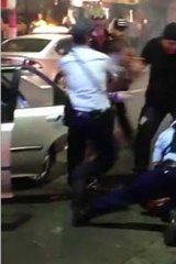 Police forcibly restrained the teenager.