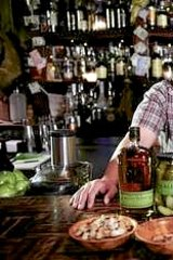 """Michelin-starred chef and Momofuku founder  David Chang with the makings of a """"pickleback""""."""