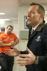 Tony Abbott talks to miners.