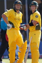 Shane Watson and Brad Haddin talk between overs against Zimbabwe.