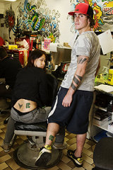 Ink-riminating evidence ... Toni Fan and Brett Gould show the tattoos they got to win free snowboards.