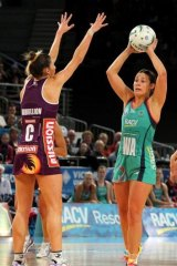 Madi Robinson (right) looks to pass under pressure for the Vixens.