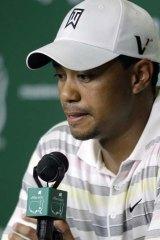 Facing the press ... Tiger Woods.