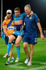 Luke O'Dwyer of the Titans is carried off.